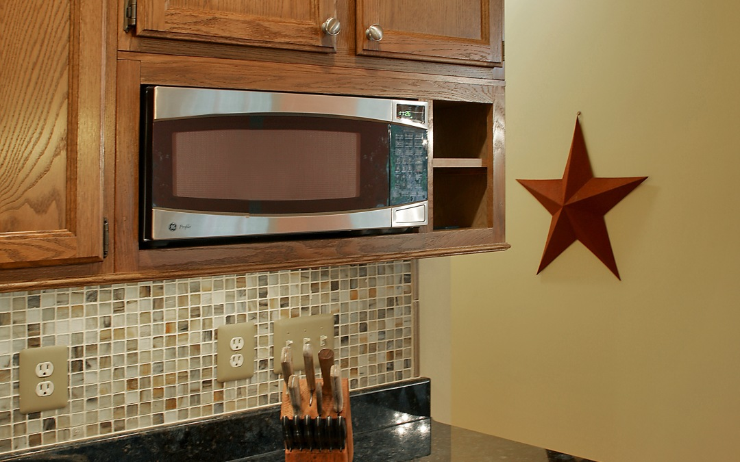 A detail of the custom microwave cabinet