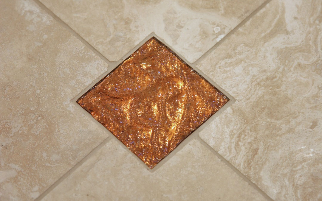One of the glass tiles used in throughout the master bathroom
