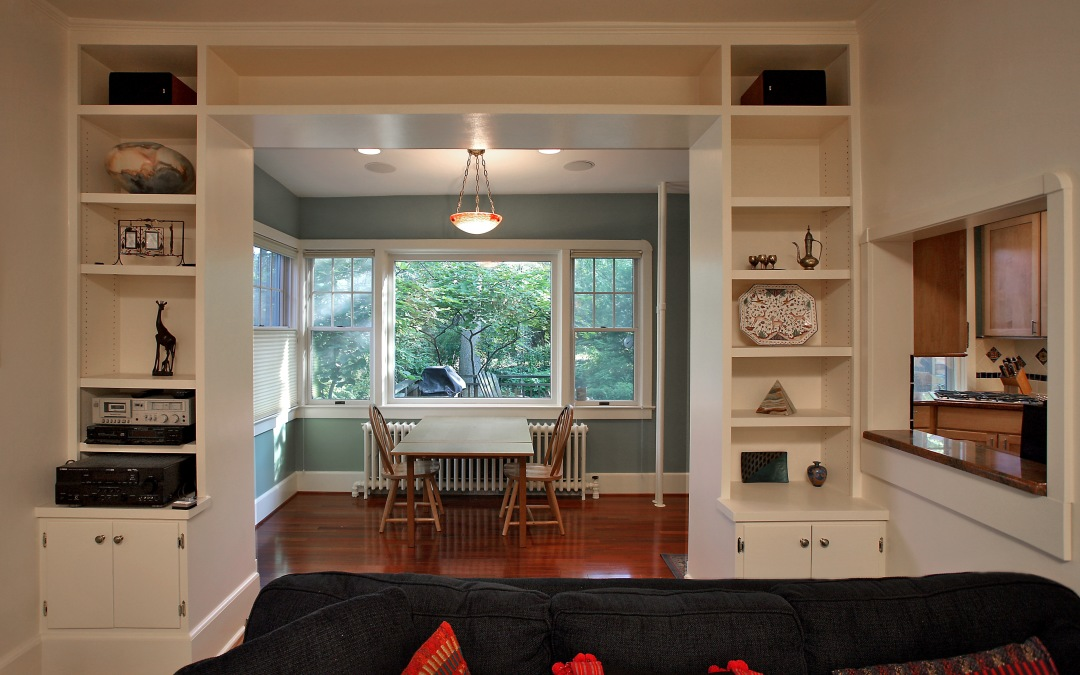 An exterior wall was removed and framed with painted built-in bookcases